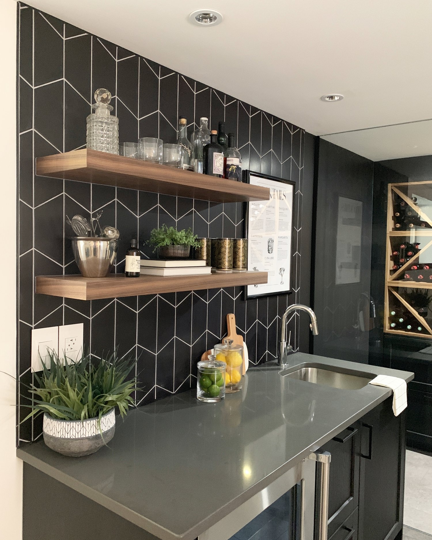 black basement bar with walnut shelves