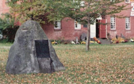 Godfrey Nims boulder in front of Memorial Hall, formerly a Deerfield Academy building.