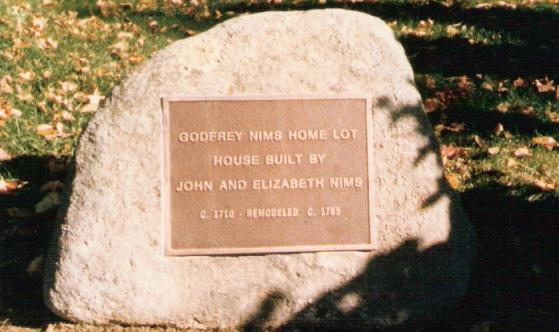 John Nims stone in front of the Nims House on the Main Street, a home now owned by Deerfield Academy.