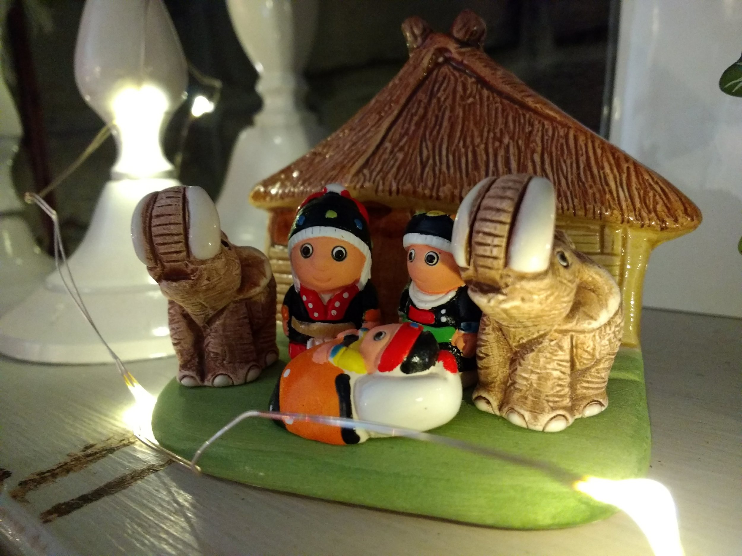 The nativity that makes no sense: made in Peru, depicting a (sort-of) Thai Mary and Joseph, with a red-headed Baby Jesus. And elephants.  Naturally.