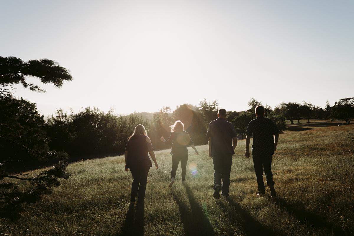 family running through field seattle