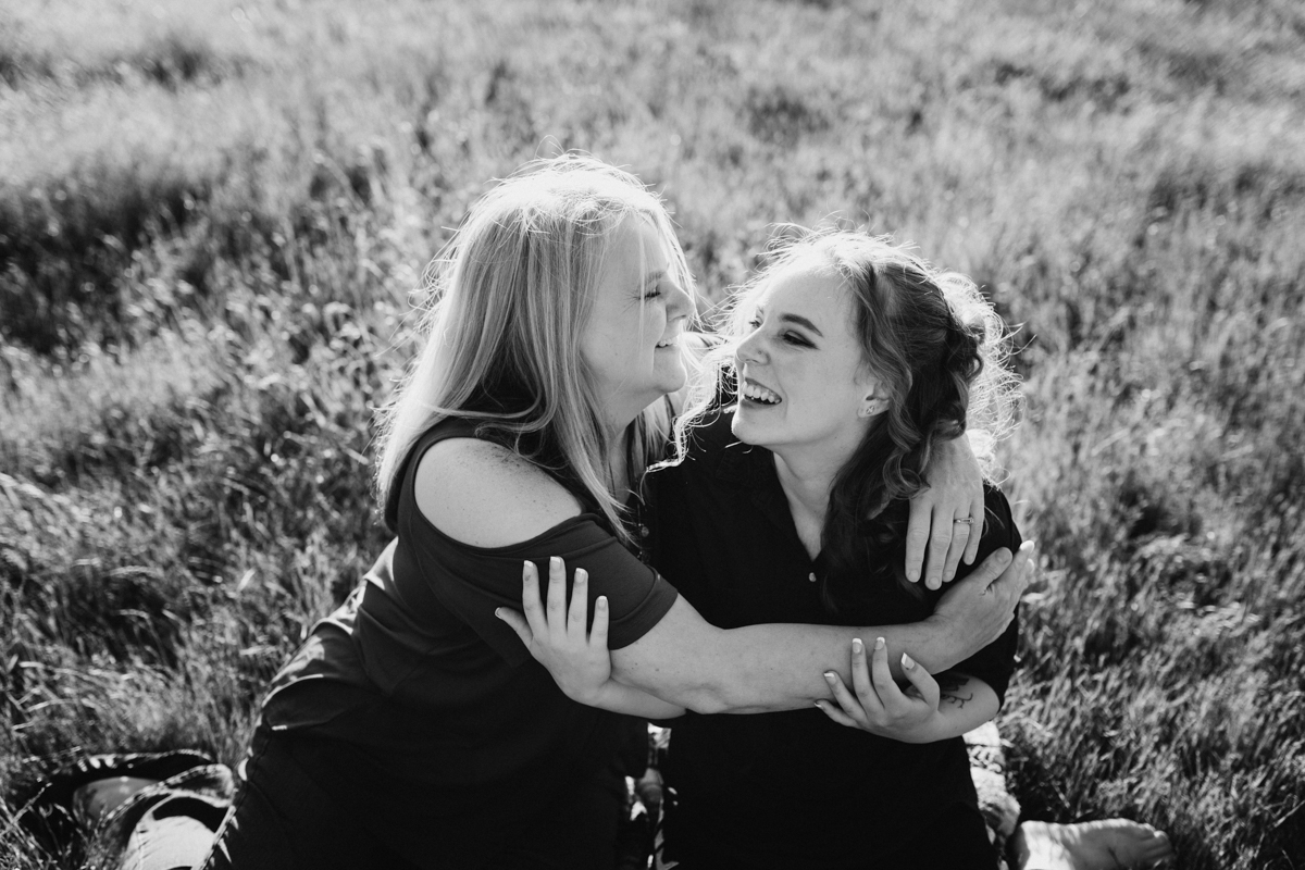 mom and daughter hugging