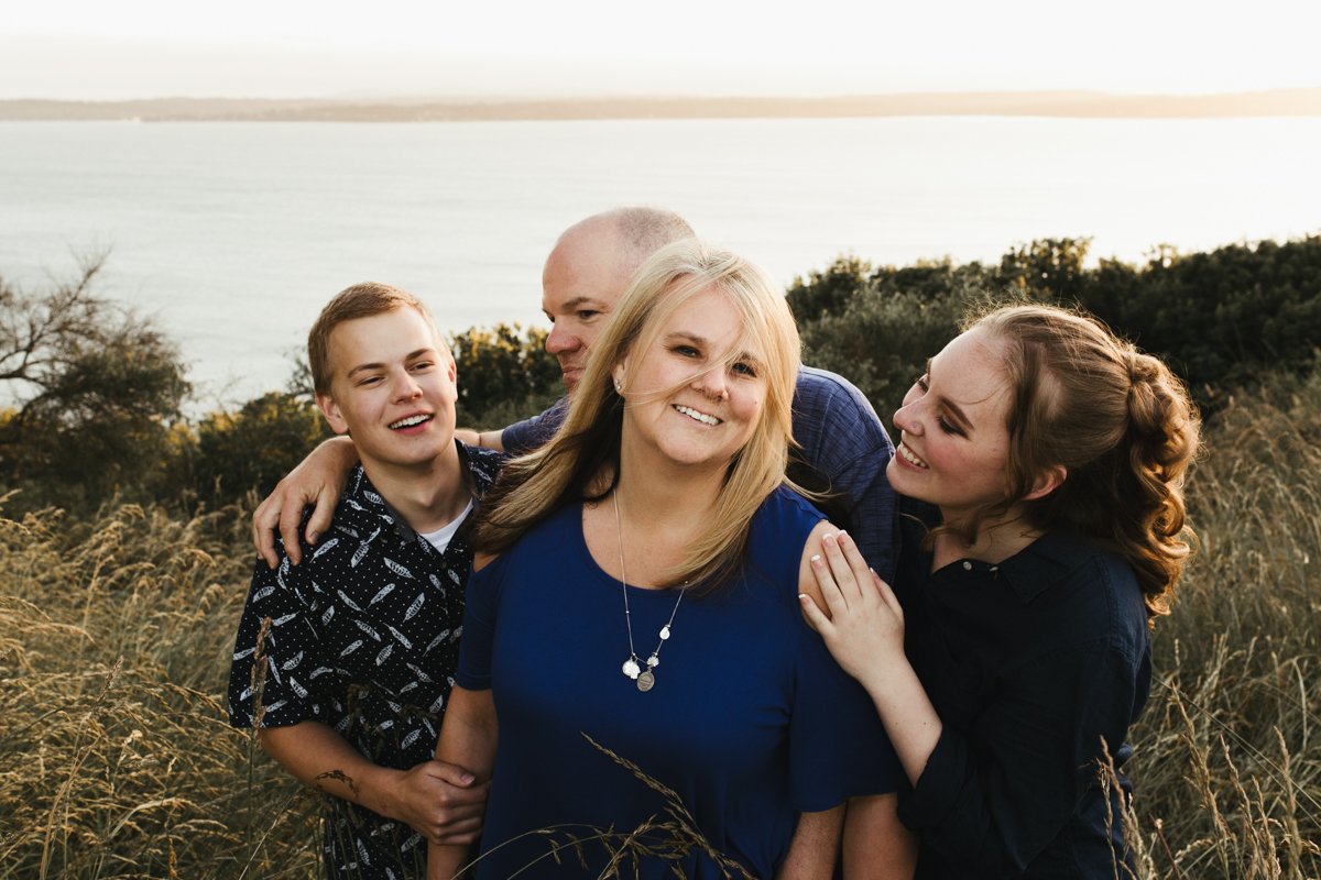 mom surrounded by family seattle photographer