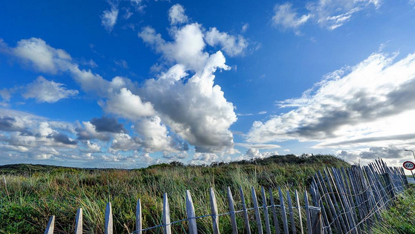 image by frankieboyphotography for us meet you there travel blog // clouds of the sea taken near haarlem beach, the netherlands