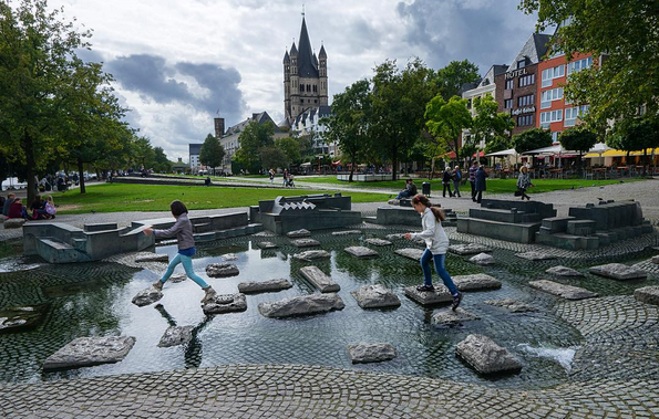 KIDS PLAY DOWN NEAR THE RHINE RIVER BANK // IMAGE FOR USE MEETYOUTHERE.ME