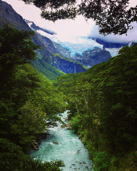CRYSTAL BLUE WATERS PUMP THRU THE RIVER LEADING OUT OF THE ROB ROY GLACIER AREA | SOUTH ISLAND NEW ZEALAND
