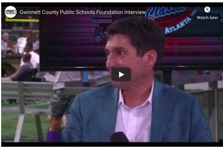 Aaron Lupuloff, executive director of the Gwinnett County Public Schools Foundation, discusses the organization during an interview at the Corky Kell Classic.