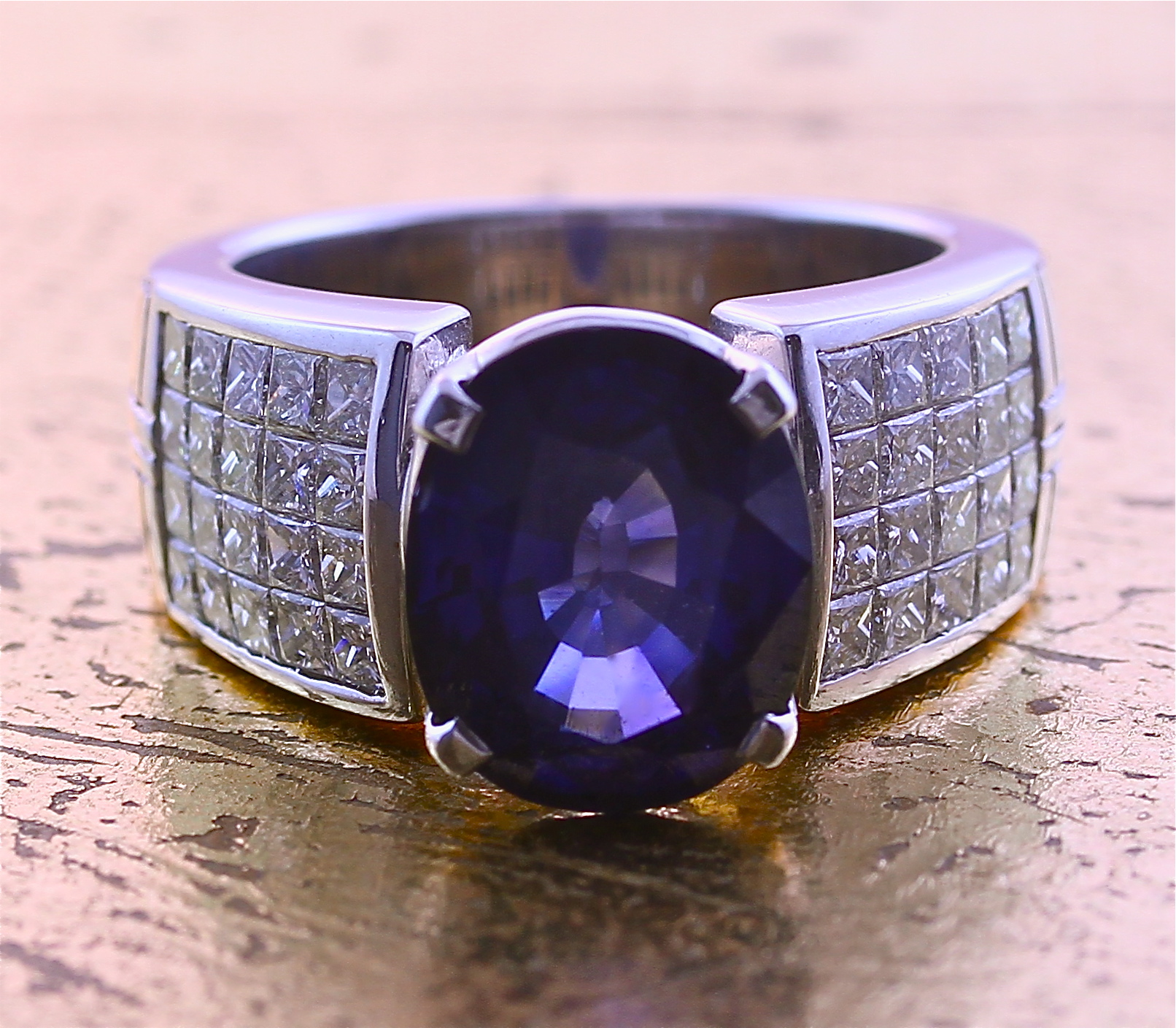 Sapphire Ring with 4 Rows of Princess Cut Diamonds in Invisible Setting - Item No: 0010305