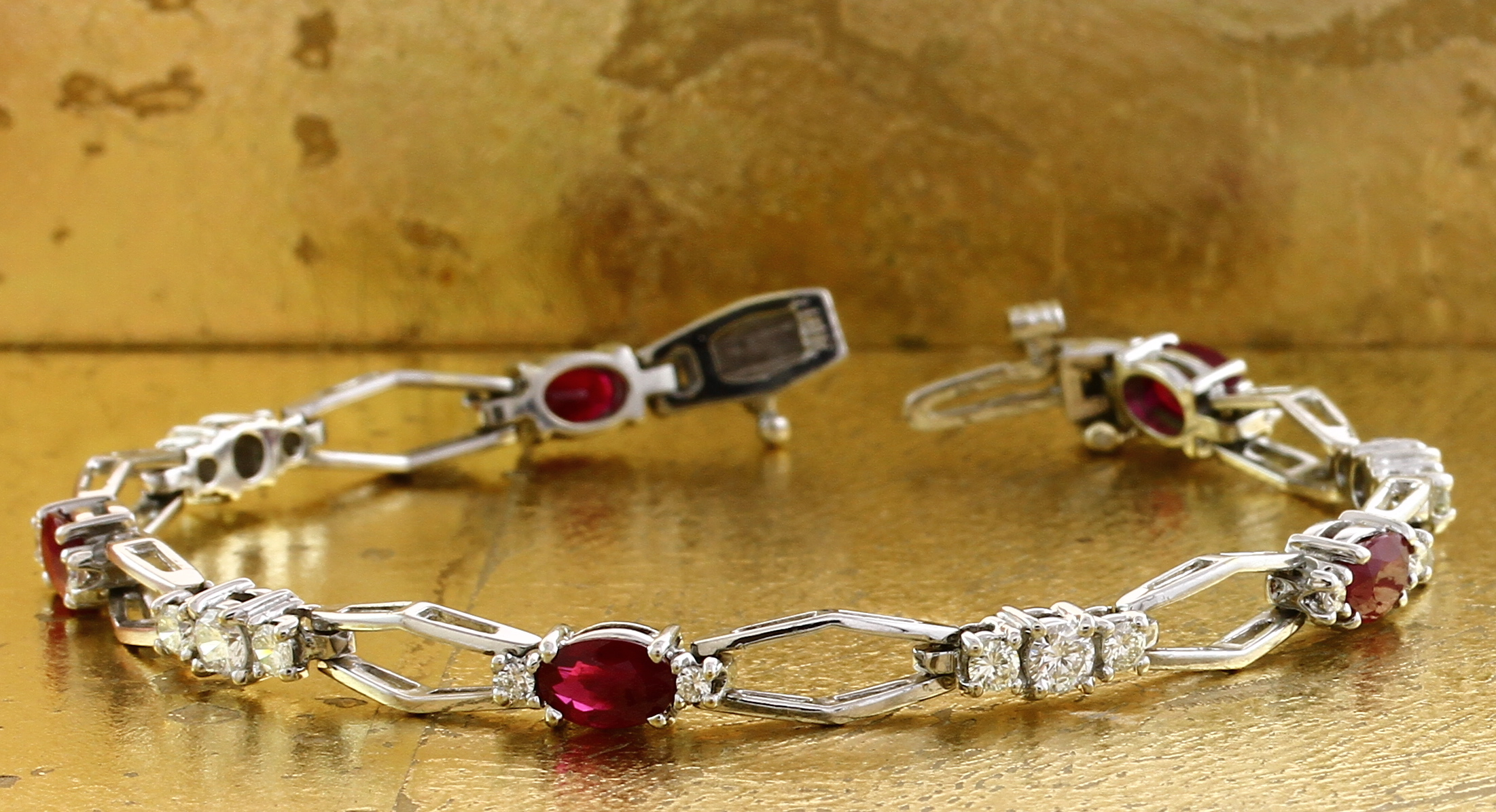 Tennis Bracelet in Oval Rubies And Round Diamonds - Item No: 0010617