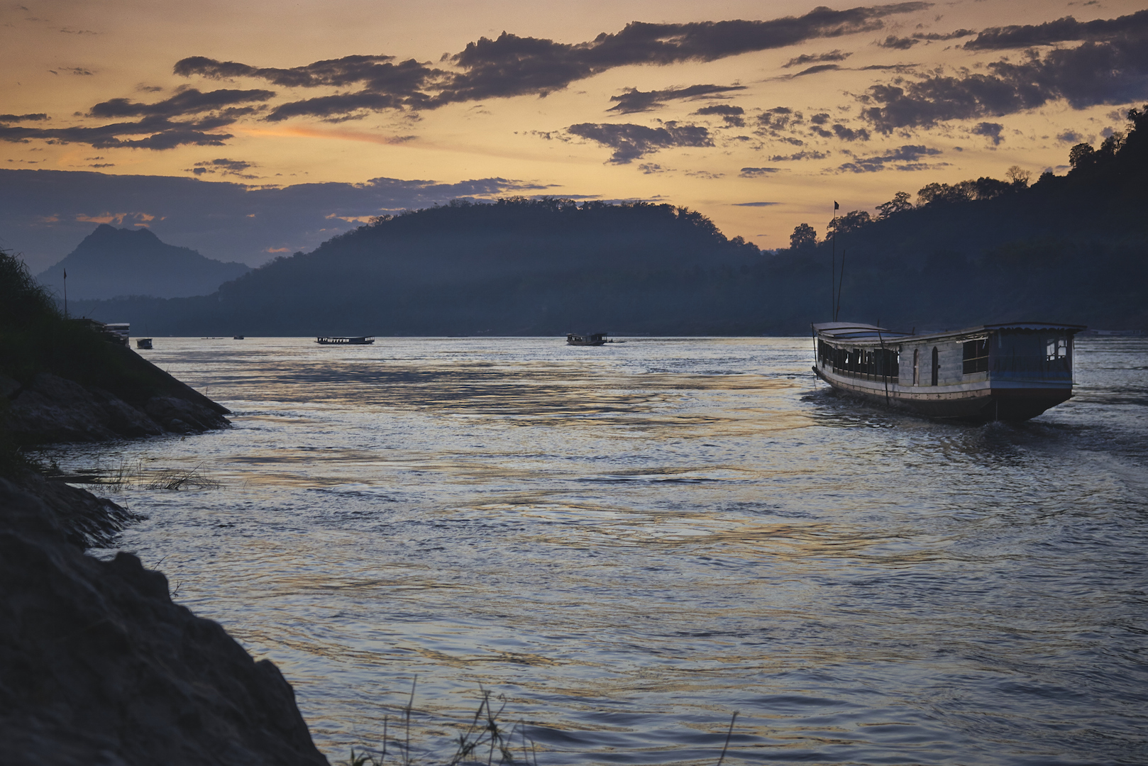 Khasar_S_SunsetSlowBoat_LuangPrabang_Laos_Winter_2014.jpg