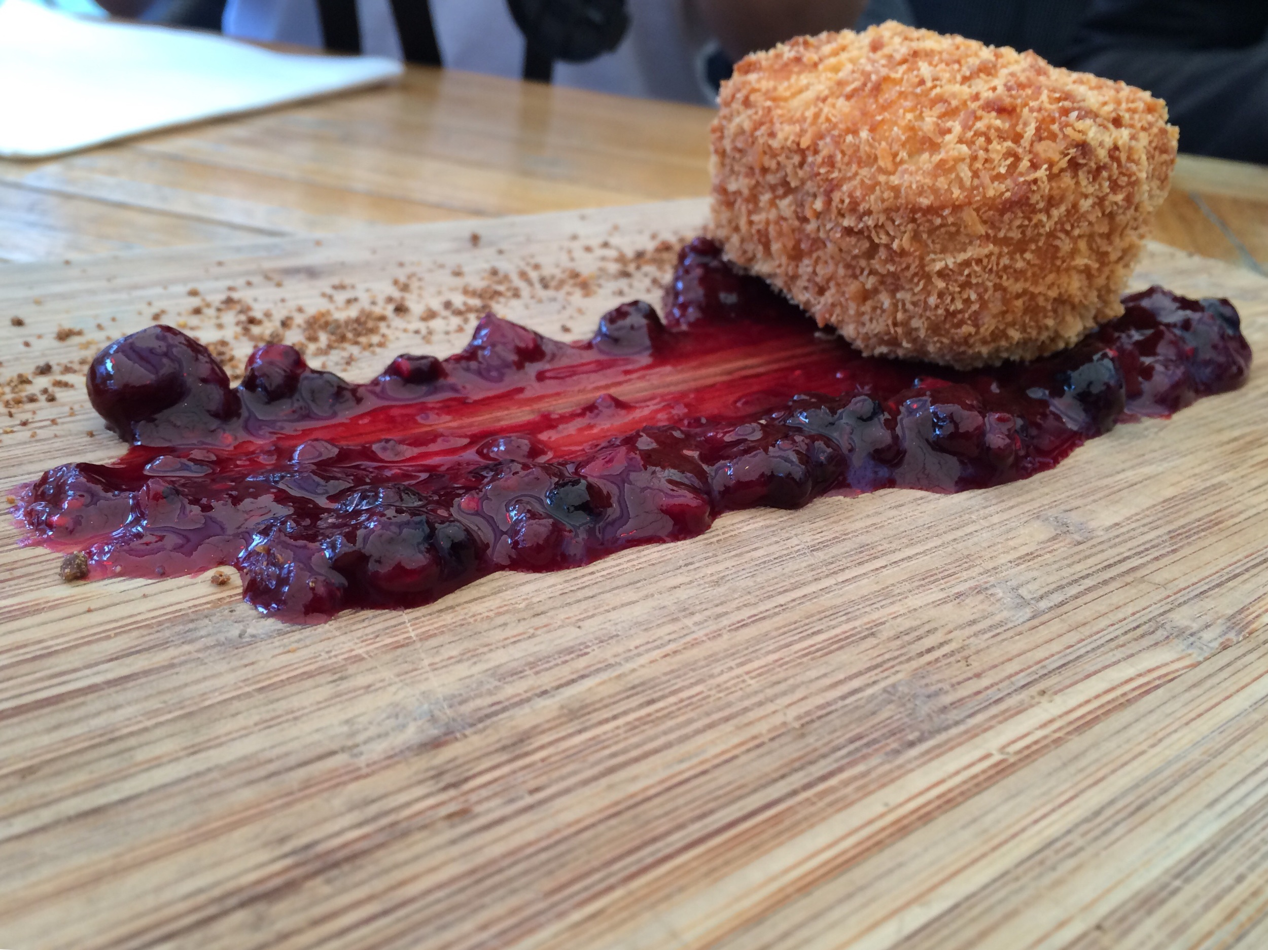 Artful board of fried cheese and cherry compote