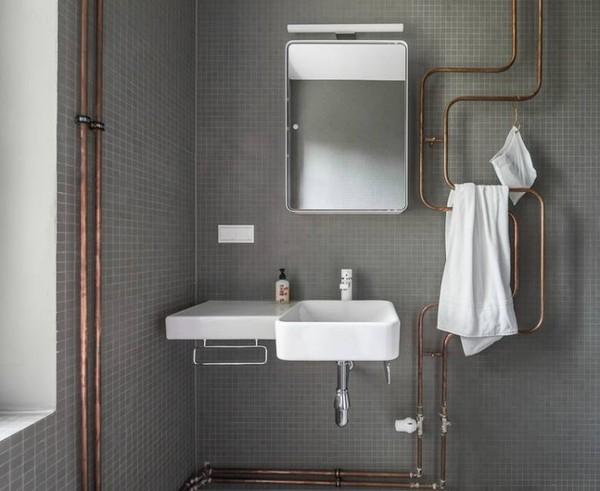 karhard-berlin-house-remodel-gray-tiled-bathroom-exposed-copper-pipes-remodelista-01_1_52553dcf9606ee7c9fc2bcfa.jpg