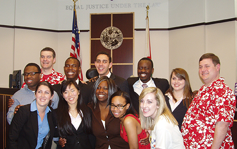 Miami A posing after a successful weekend in the courtroom.  Back row, left to right: Zowoi Malakpa, coach Neal Schuett, Brandon Patterson, Alex Block, Brad Ouambo, Allie Pickerell and coach Dan Haughey; front row: Lauren Yates, Claire Meikle, Deborah O'Neal, Jazmine Kee and Katie O'Keeffe (photo by Susan Meikle).