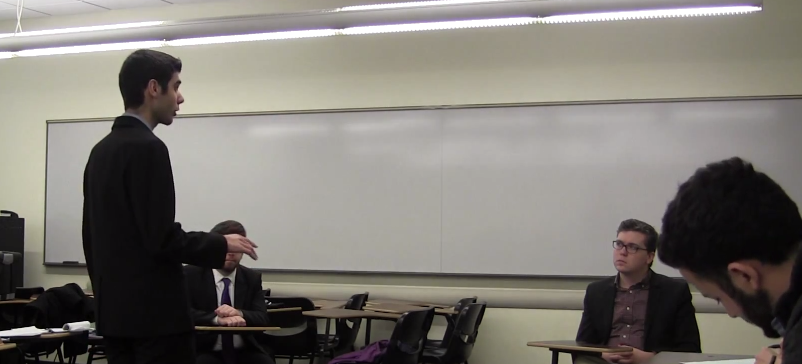 Oliver Zoellner (right) handles a cross examination by Loyola Chicago