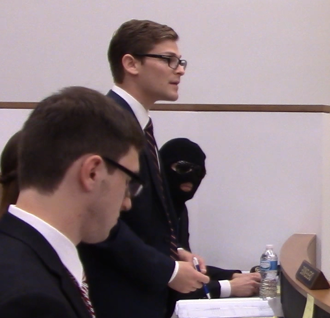 Junior Adam Korn introduces the Prosecution Bench