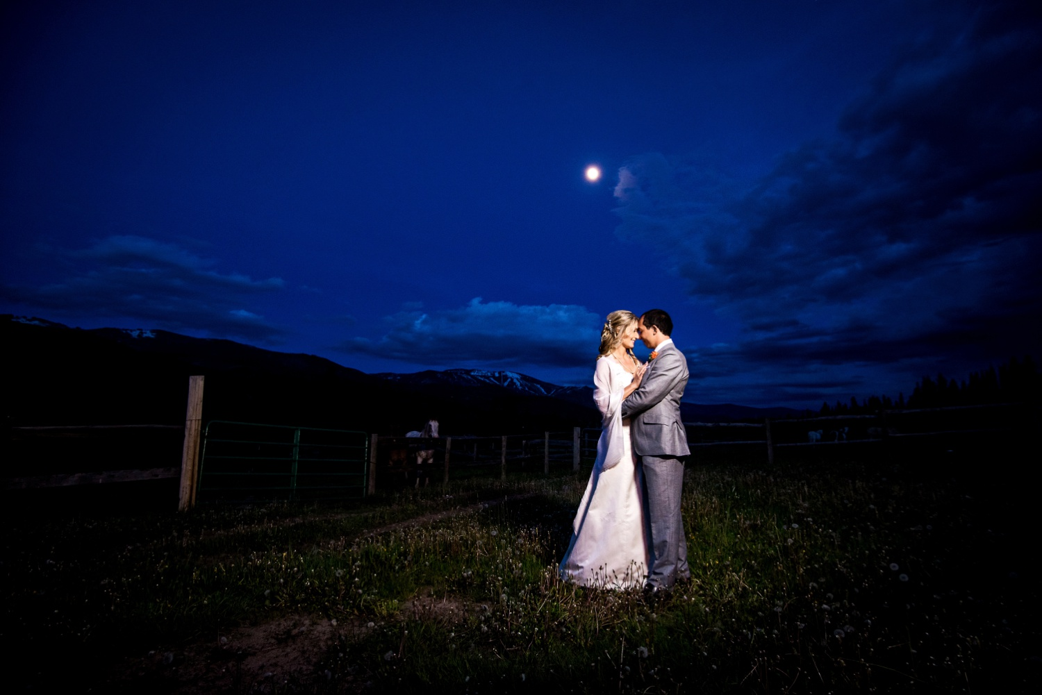 Night portrait of bride and groom at Ranch wedding at Perry-Mansfield in Steamboat Springs, Colorado.