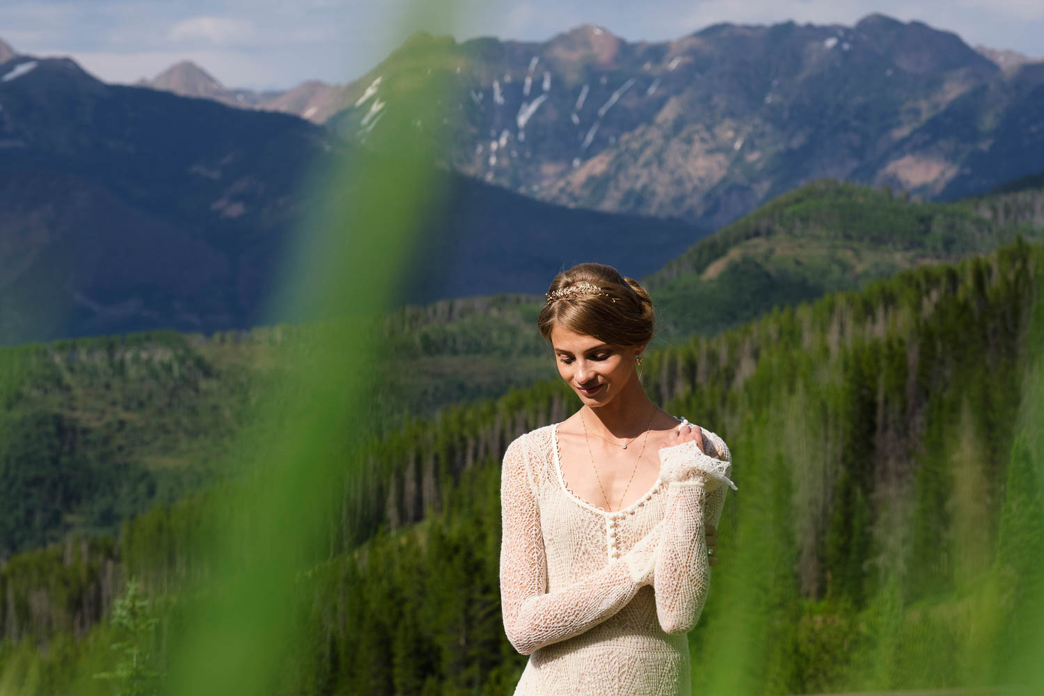 Anna Selzneva poses against mountain backdrop in Vail.  Fashion model Anna Selezneva's wedding in Vail Colorado.  Wedding ceremony at the Vail Chapel.  Wedding reception at The 10th on Vail Ski Resort.