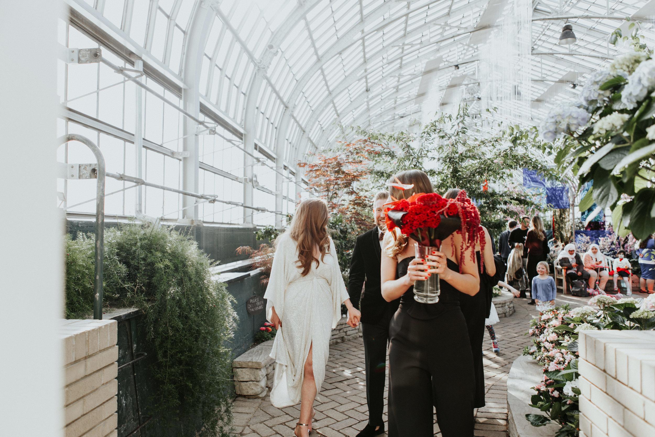 candid wedding photographers Garfield Park Conservatory