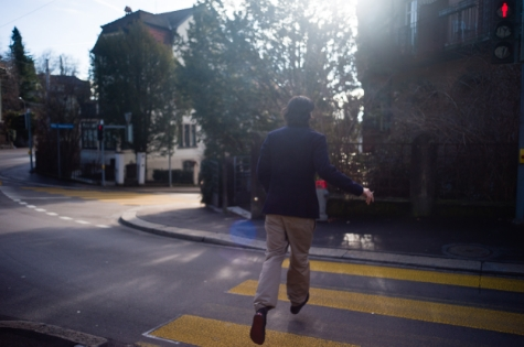artist charles munka in the streets of zurich, photography by laurent segretier