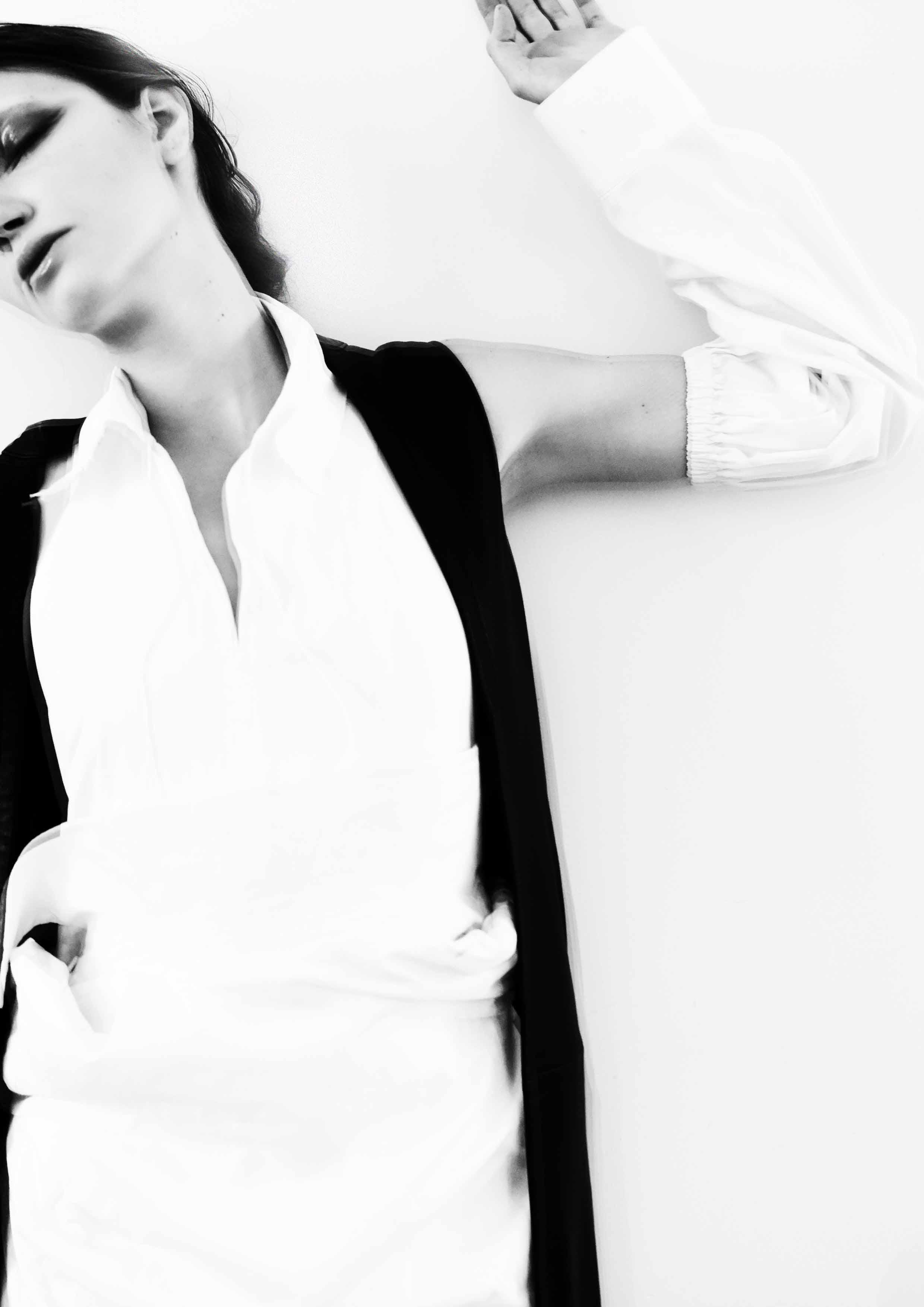 white shirt Irakli, trench Yuhl Jung, sleeveless black coat Ainur Turisbek, white sleeves Vetements