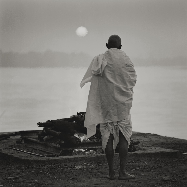 'eternal light' varanasi. india 2014. at a village of raj, public cremation ground along the ganges. by kenro izu