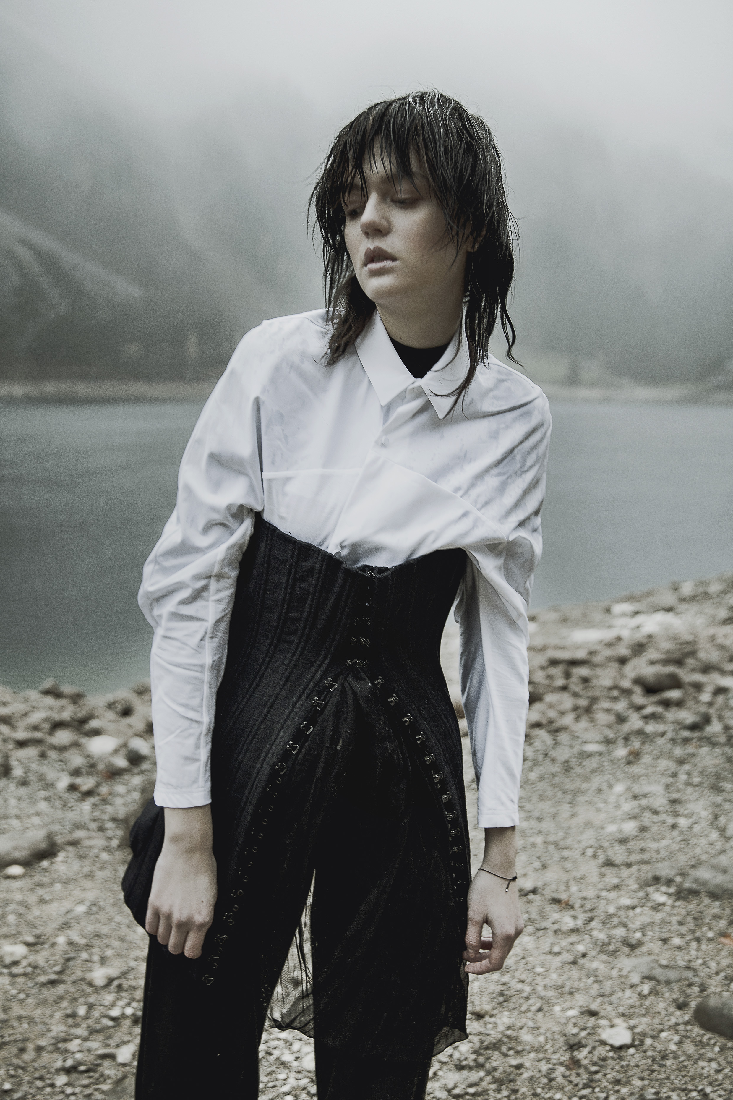 White cotton bat sleeves blouse by Kenta Matsushige | Black corset by Olivier Theyskens | Black Woolen wide leg trousers by Moon Young Hee