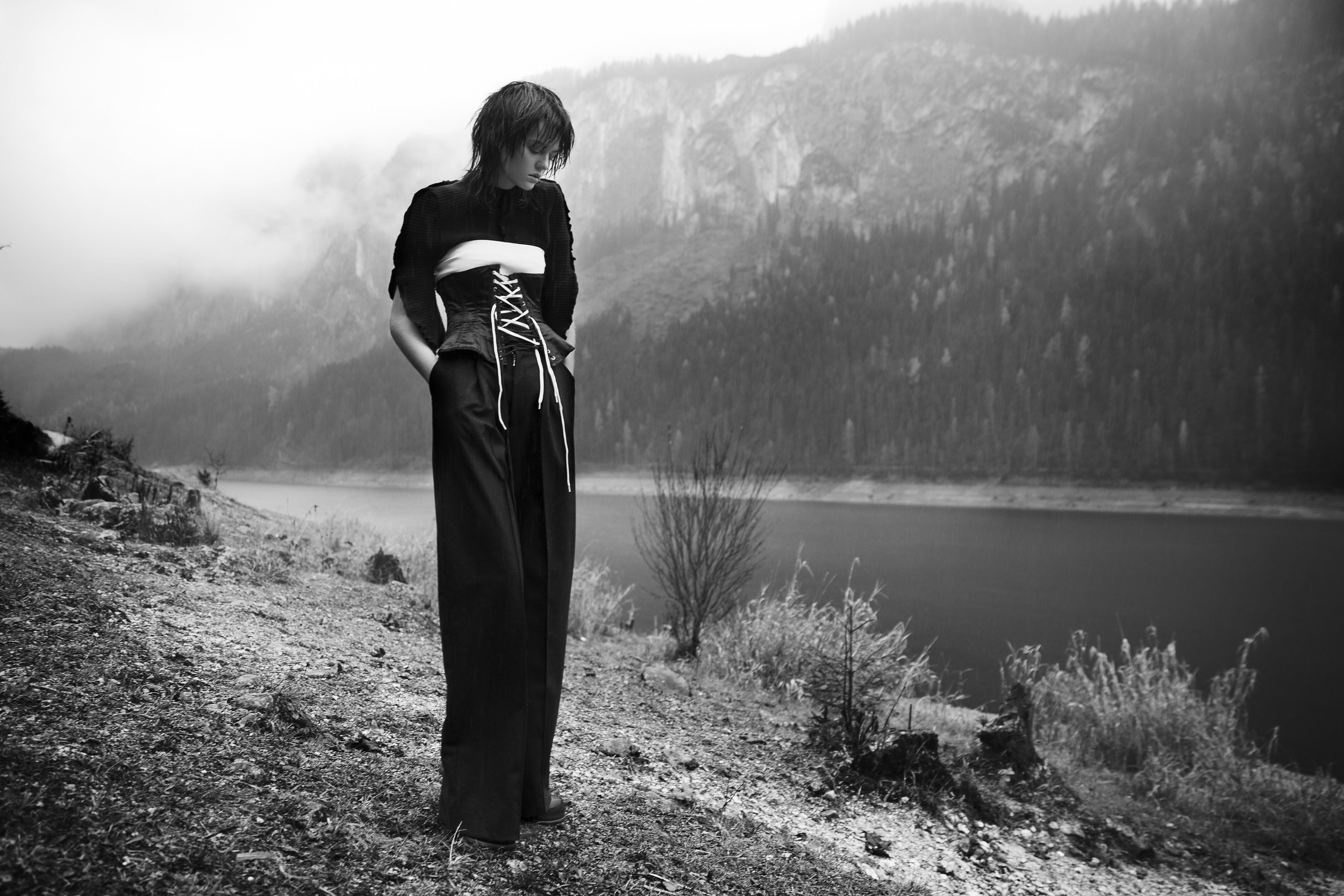 Black ribbed sweater &white bra made of coated fabric by Lea Peckre | Customised corset by stylist | Black Woolen wide leg trousers by Moon Young Hee | Leather ankle boots by Göran Horal