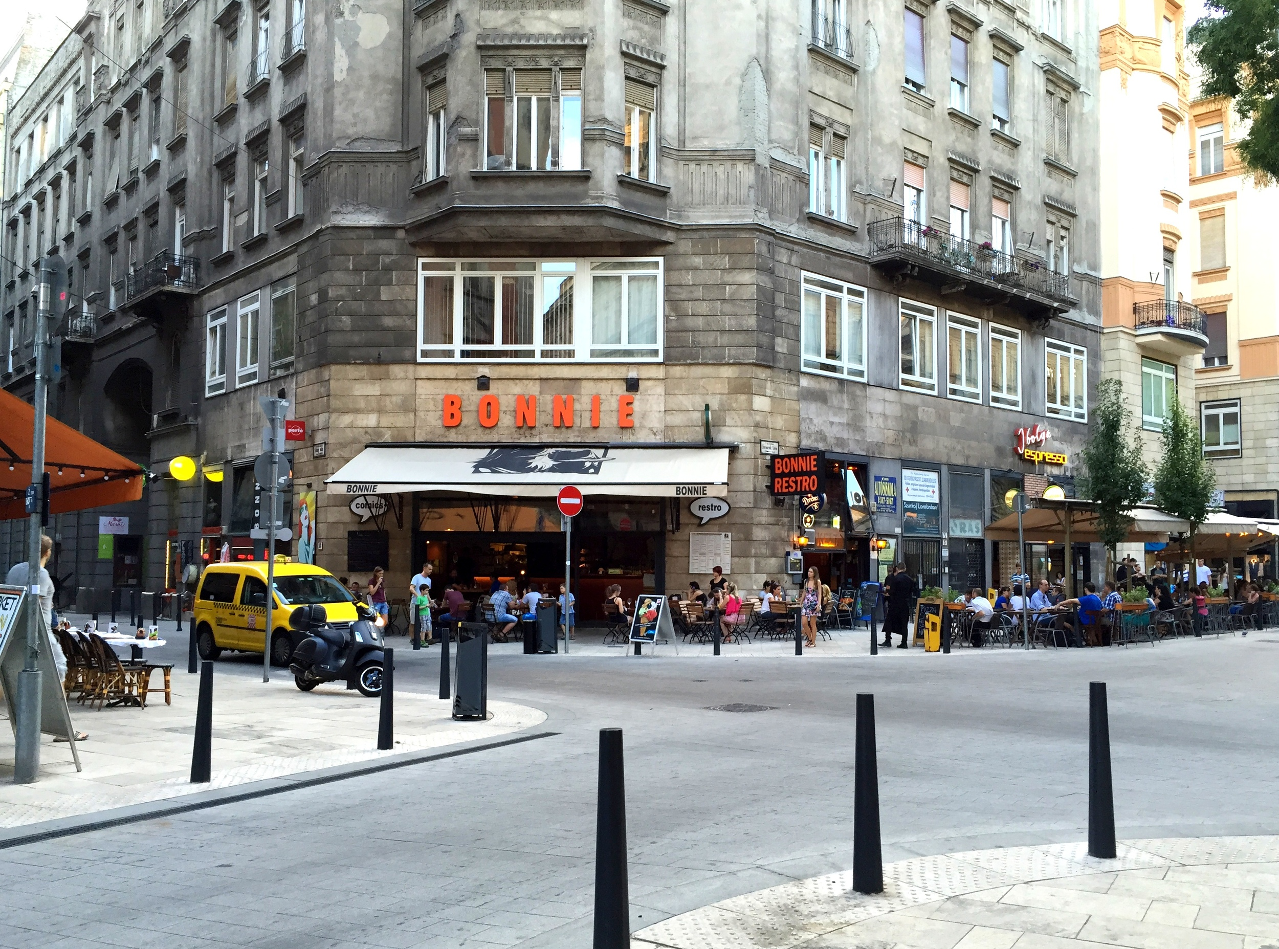 A typical street corner is lined with cafes and restaurants in the city center.
