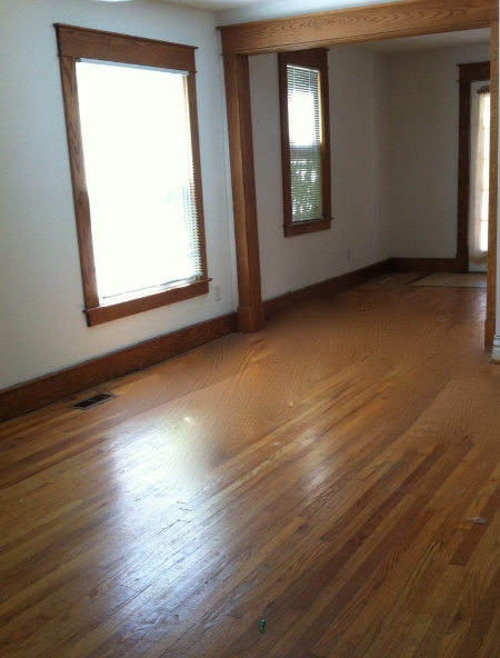 Window and door trim custom fabricated and installed to replicate the original oak in this 1900's era home in Lansing MI