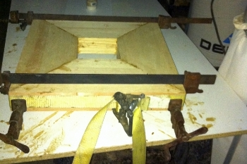Start by gluing up several pieces of wood for the base