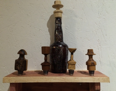 5 turned bottle stoppers made by George Wurtzel at his shop in Minneapolis.