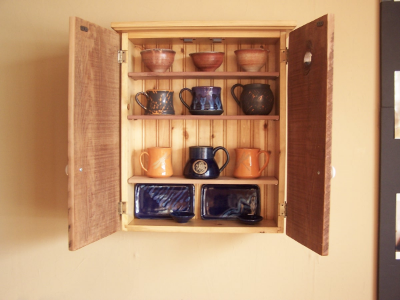 "Pine Cabinet with shelves filled with ""knick knacks""."