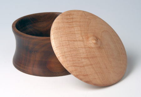 Round walnut box with curly maple lid