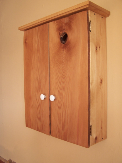 Pine cabinet made with recycled wood from 1870's house.