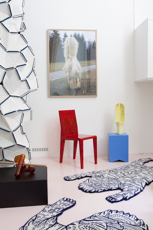 François Azambourg's 'Tres Jolie' chair along with 'Tiger' rug by Dylan Martorell, glass vases, 'Parade', by Jean-Baptiste Fastrez, 'The Cave' light by Benjamin Graindorge and the stool 'Box' by BIG-GAME. All from the  Moustache  collection. The fabric room divider 'Clouds' is by the Bouroullec brothers, Ronan & Erwan, for Kvadrat.