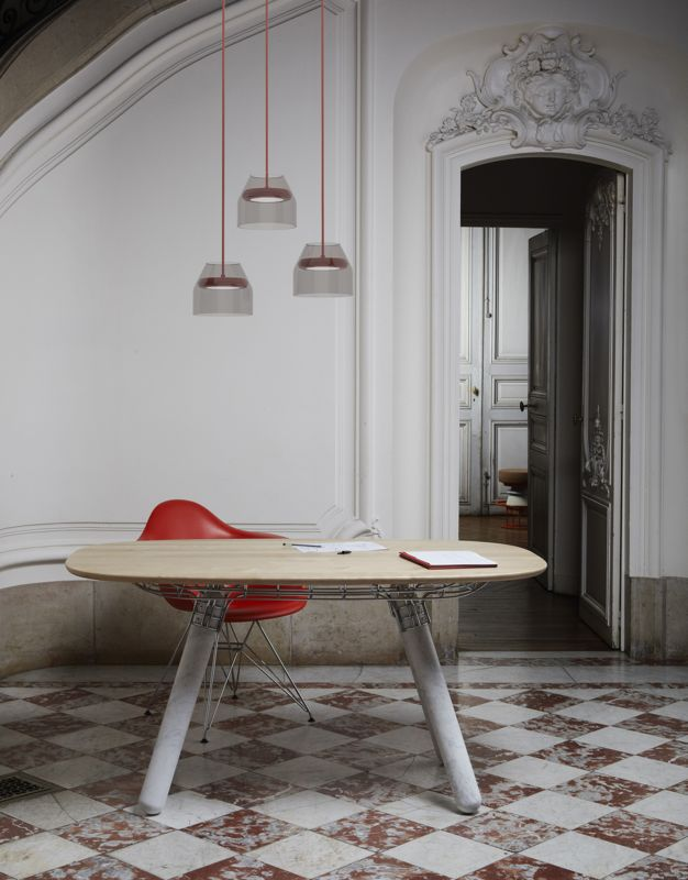 La Chance hopes to fill the gap between the big brands and the excitement and originality of small design studios. The table shown is 'Magnum' by Pierre Favresse. The LED pendant lights, 'Hal', are by Guillame Delvigne.
