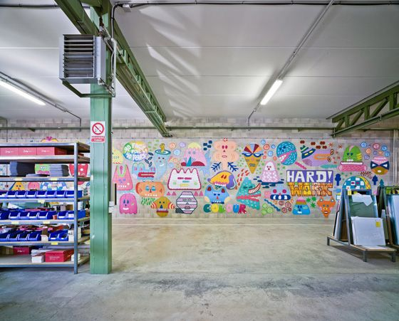 Other parts of the Sancal factory have been given the mural treatment too. This particular example is by Barcelona graffiti artist Zosen Bandido depicting 40 faces or masks - one for each year of the company's existence.