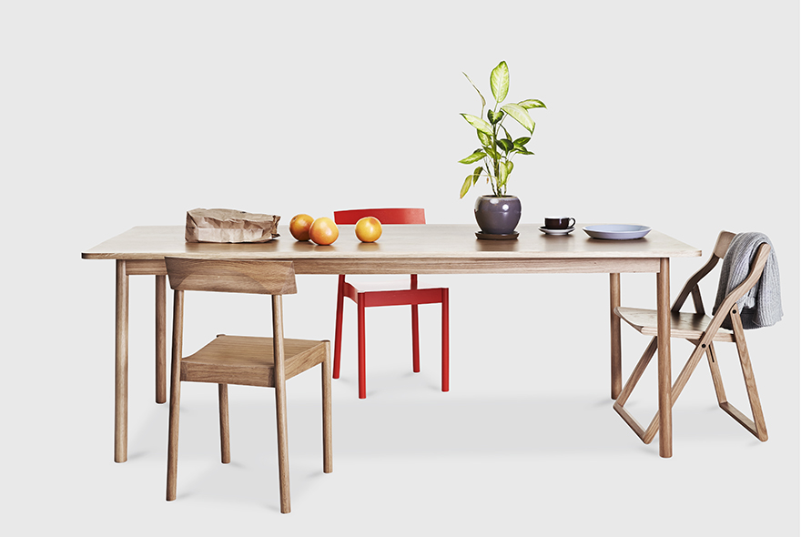 The 'Time' table in clear finished oak with two 'Woodstack' chairs in different finishes and the folding 'Storyteller's' chair.