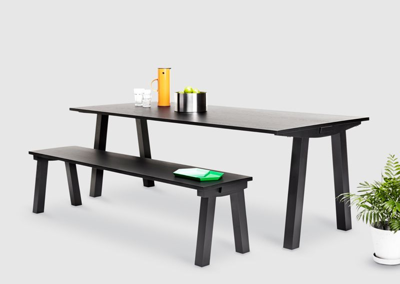 The 'Dove' bench and chair in black painted oak.