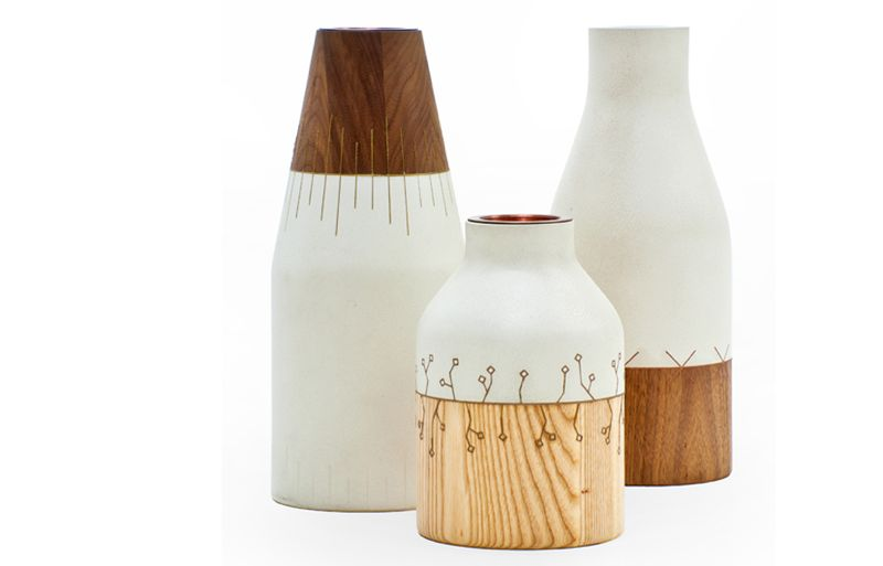 Matthew Sheargold's 'Kintsugi' vessels combine a sort of ceramic made from concrete 'shale' and timber with a delicate metal inlay . Shown here, the two rear vessels have walnut timber parts while the front example uses ash. The inlay is in brass. There are 16 vessels due for release over time. Currently five are available.