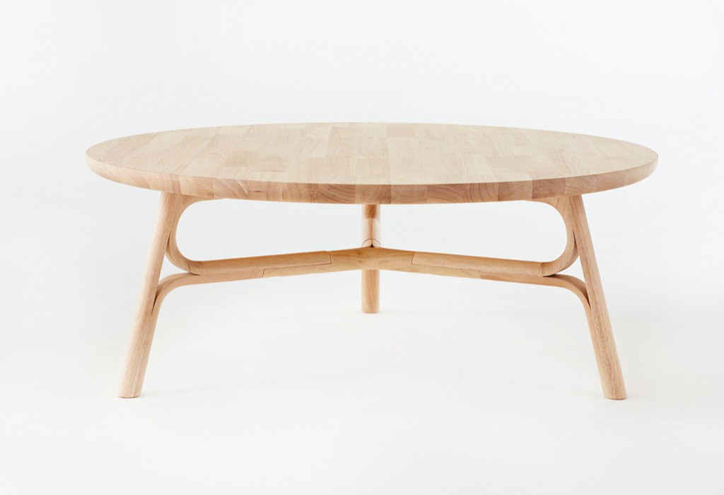 The 'Flow' coffee table by Justin Hutchinson in natural rubberwood. The table can also be specified with the base lacquered in colours or the entire design can be stained black.