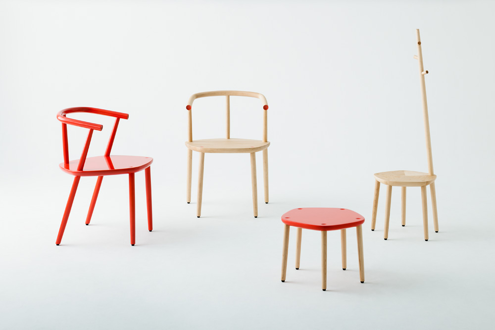 The 'Five' collection can be specified in a red lacquer or with the leg and arm end points expressed in the same red.  Photography by Takumi Ota