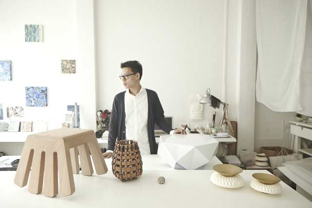 Melvin Ong in his studio. His designs from left to right include the 'Itty Bitty' stool, the 'Leather Basketry', 'Rok' paperweight, 'Monolith' side table and 'Mappa' serving bowls.