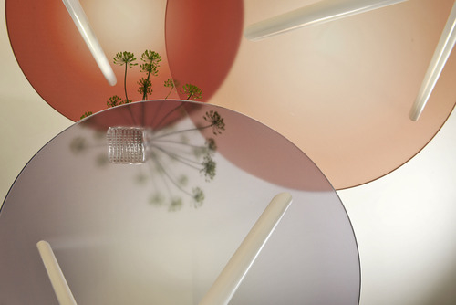 An overhead shot of the 'Spring' tables by Thomas Eurlings for Buhtiq31. The tops are in ruby, beige and light mauve.