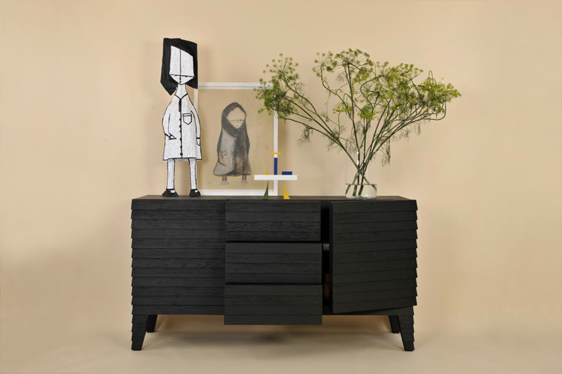 The 'Clad' buffet/sideboard has a beautifully textured surface courtesy of the use of a simplehorizontal cladding technique.