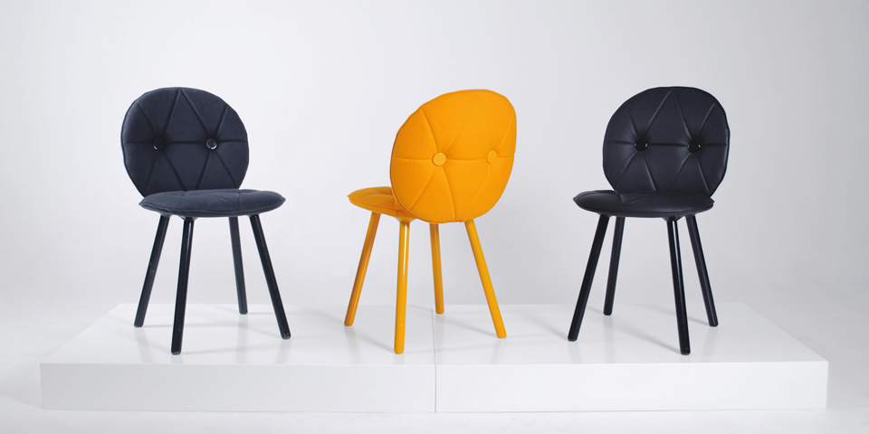 Markus Johansson's 'Harlequin' chairs are now in production with Italian company  Tekhne  . Shown here in fabric and leather (far right).
