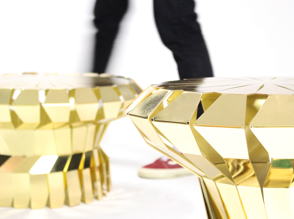 Golden anodised versions of 'Fortress' stools in close up.