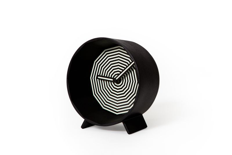 The 'Herman' clock's op art face glows in the dark - a bright luminescent green.Photo: Christian Nerdrum.