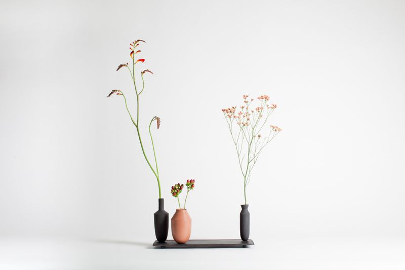 The 'Tangent' vases are connected to their timber plinth by extremely strong earth magnets.Photo: Christian Nerdrum