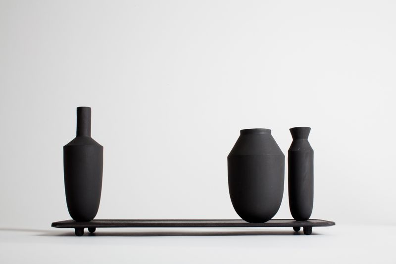 Totally graphic in the black form, the 'Tangent' vase setting doesn't really require flowers.Photo: Christian Nerdrum